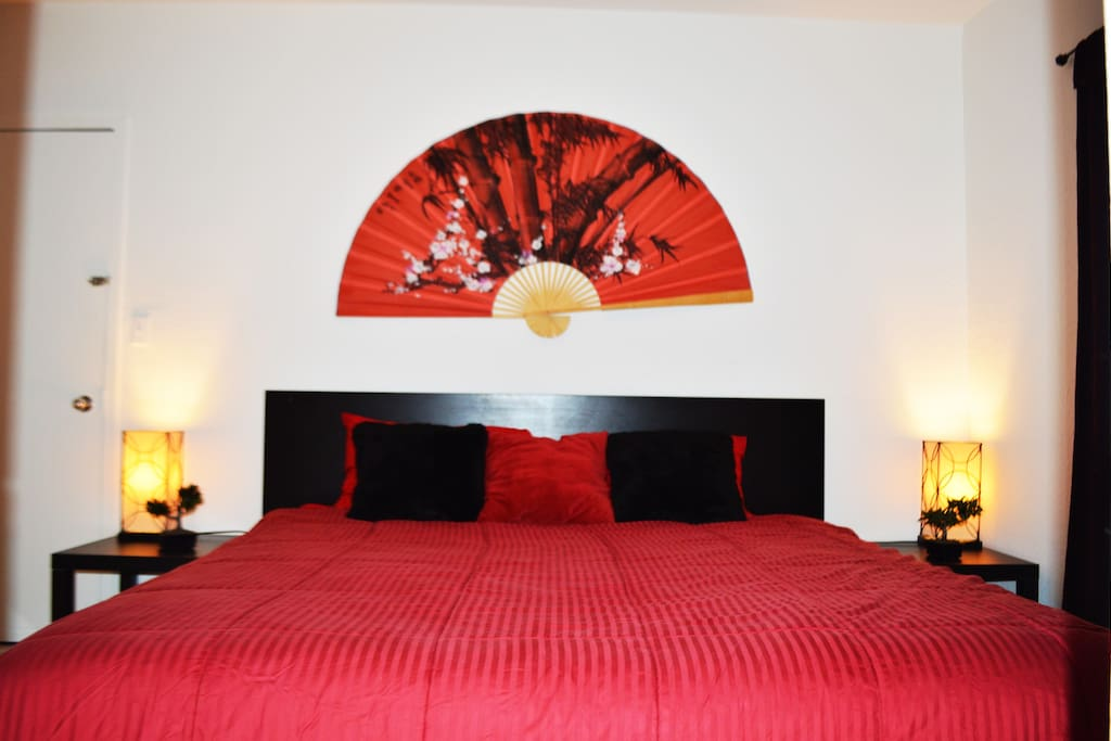 asian style bedroom with king-size bed