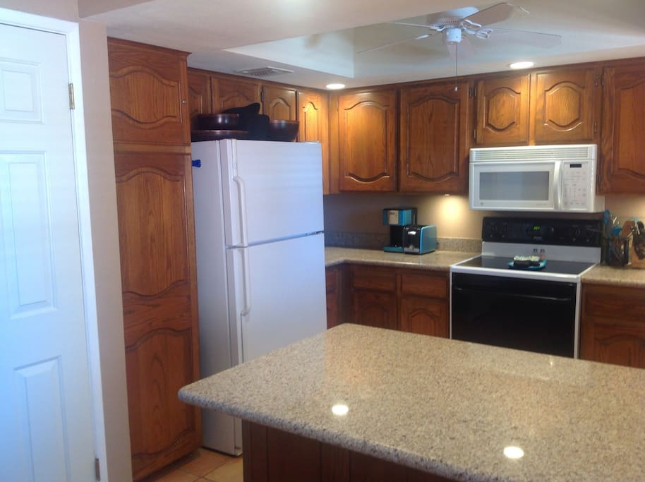 Open and updated kitchen with all the dishes, cookware, & extras you will need