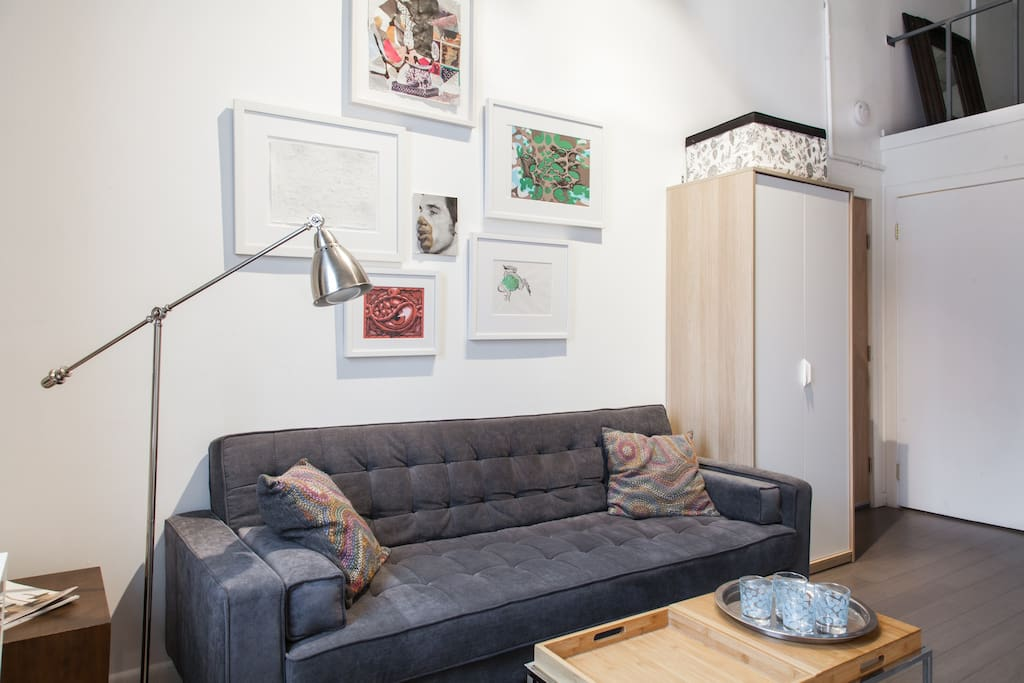 living area with art, books and fold out sofa bed