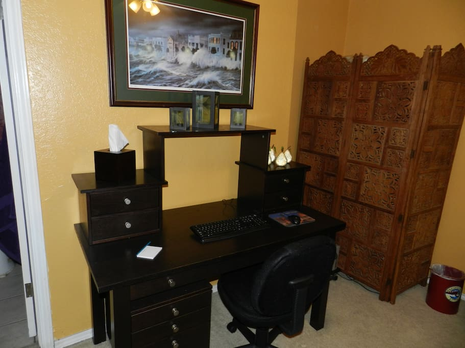 The desk in the guest bedroom