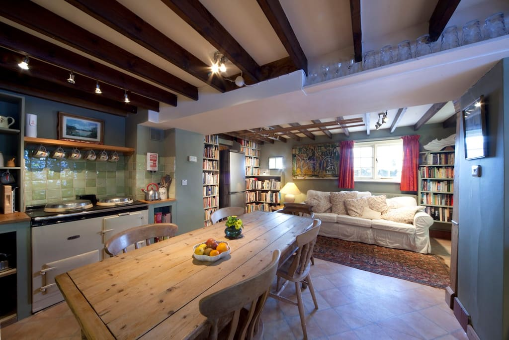 Kitchen, Aga, squishy sofa,overflowing bookcase ensures whoever cooks will have company!