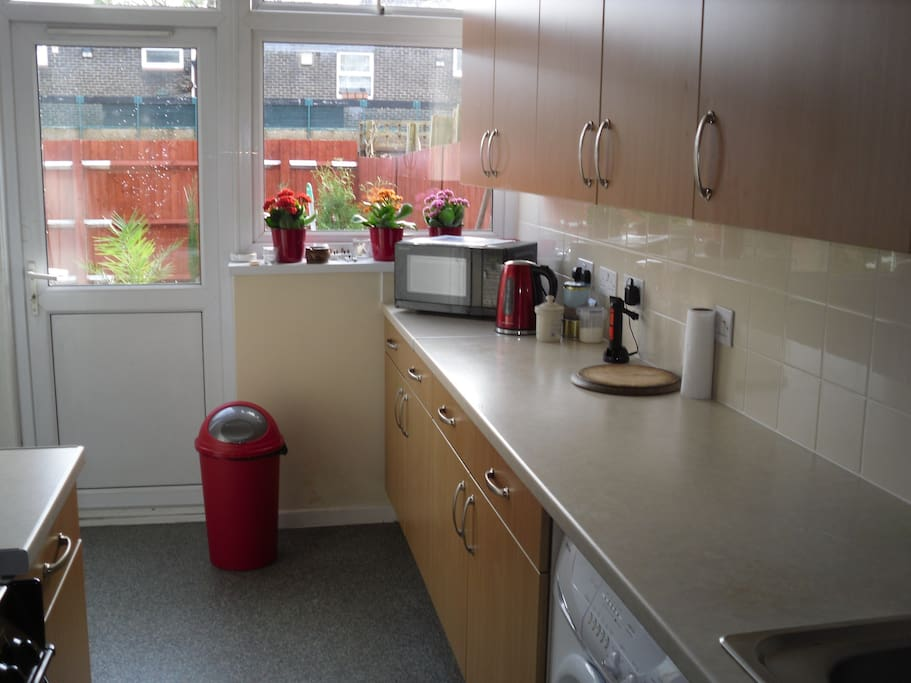 Nice kitchen overlooking attractive garden.  You can use the microwave and make hot drinks.
