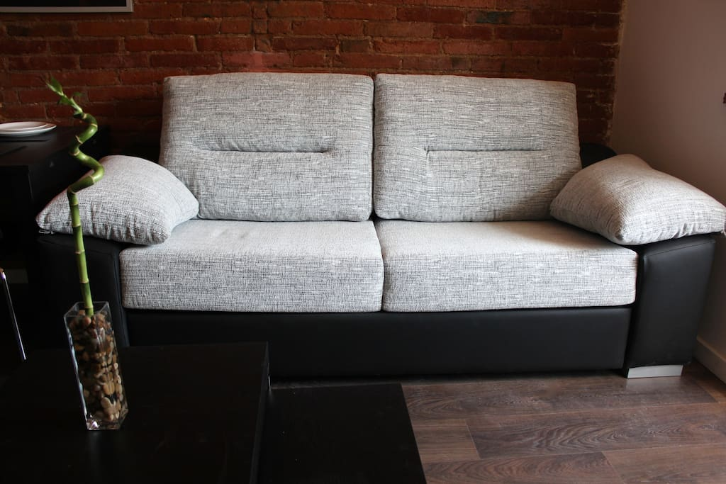 Living room sofa-bed in closed mode