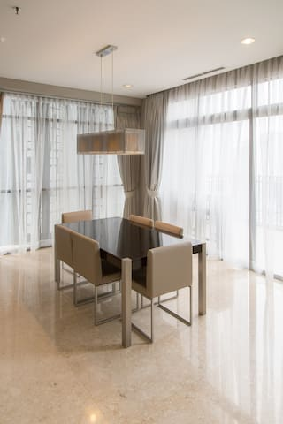 Dining room with a view of Jakarta's skyline