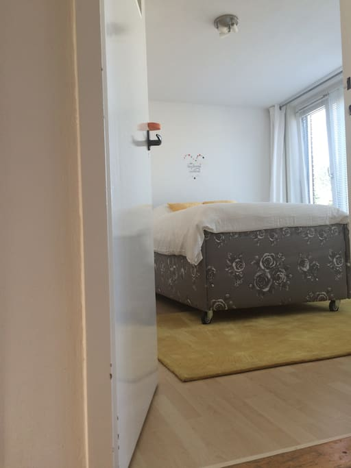 Birdy Bright is a beautiful and clean bedroom with bright   light, natural furniture and happy yellow details.