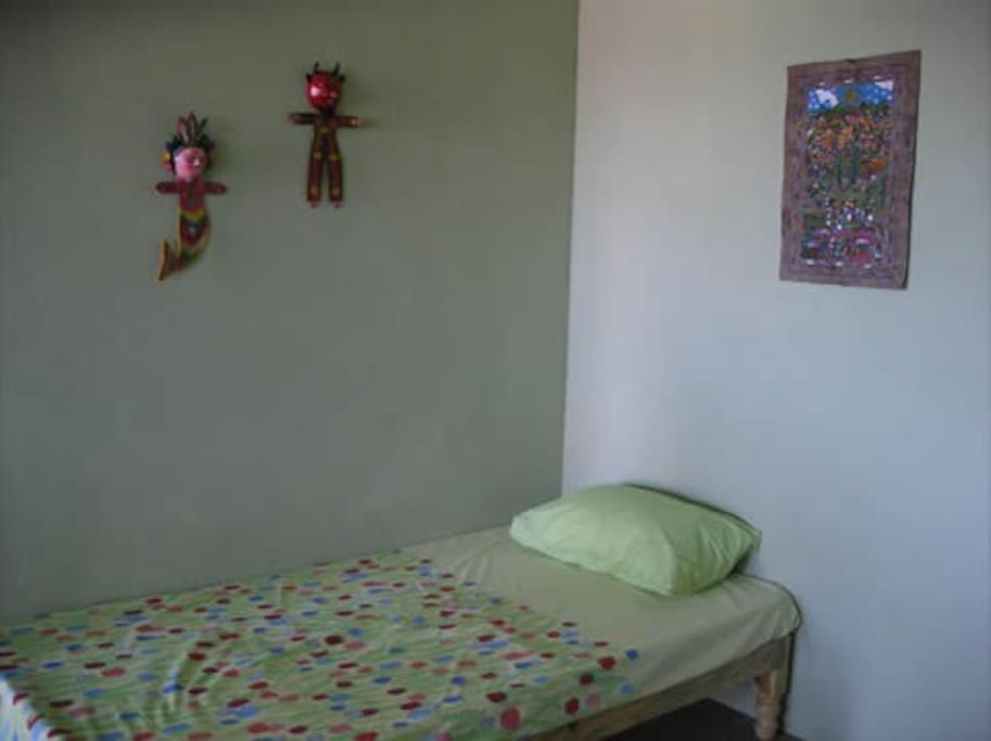 Single bed in living area.
