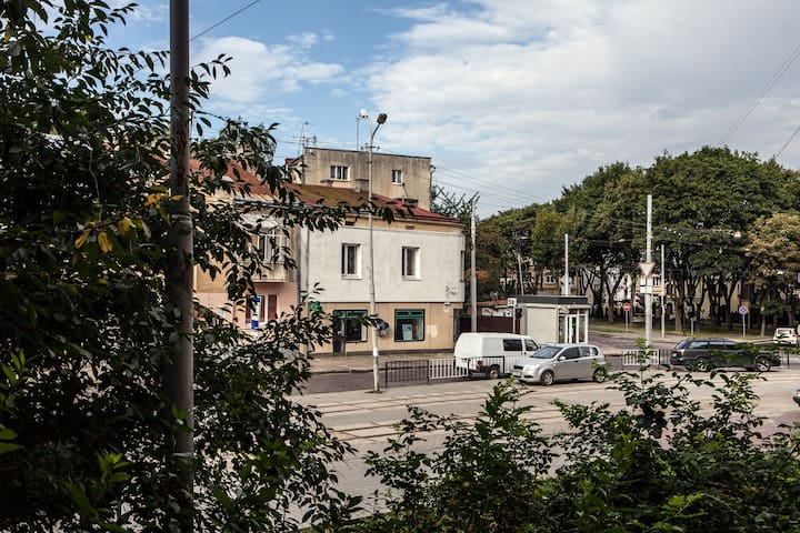 View from the windows of the apartment on the streets crossing and small park zone