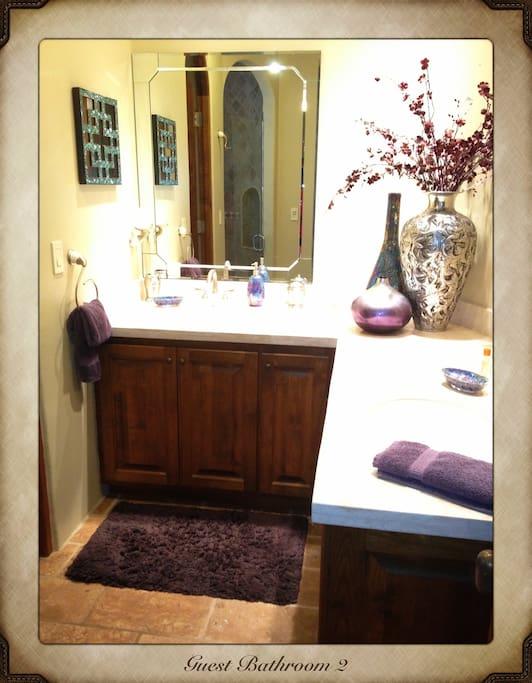 Guest Bathroom: Walk-in Shower & Dual Sinks.