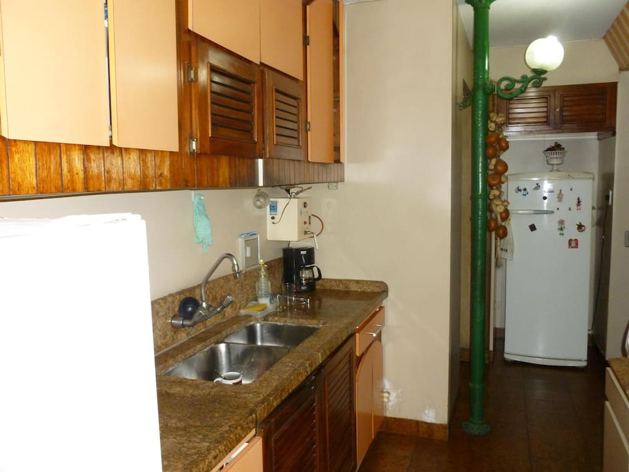 Kitchen, very spacious and completely equipped. Service area with wash machine and with service bedroom and bathroom.