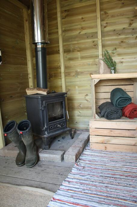 Wood burner stove in each cabin