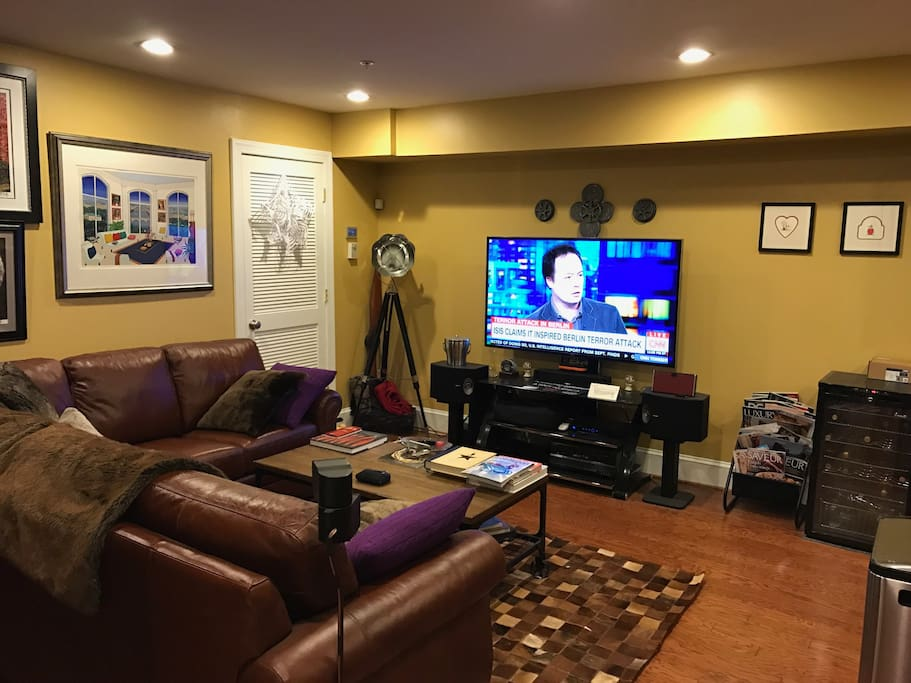 """Large living room with 60"""" LED HD TV, full DirecTV package, BluRay and surround sound"""