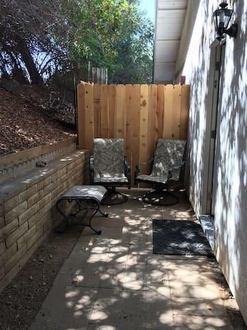 Outdoor seating at room's entrance