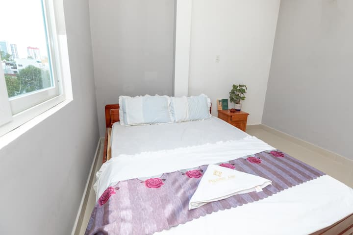 Tem House Superior Double Room with city view.