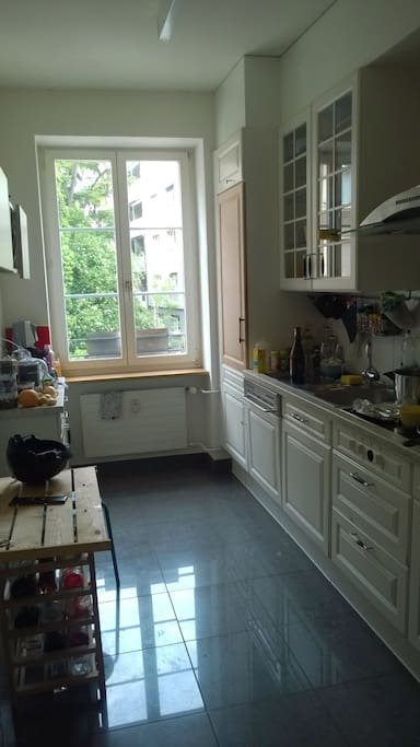 big shared kitchen with microwave, oven, dishwasher, fridge