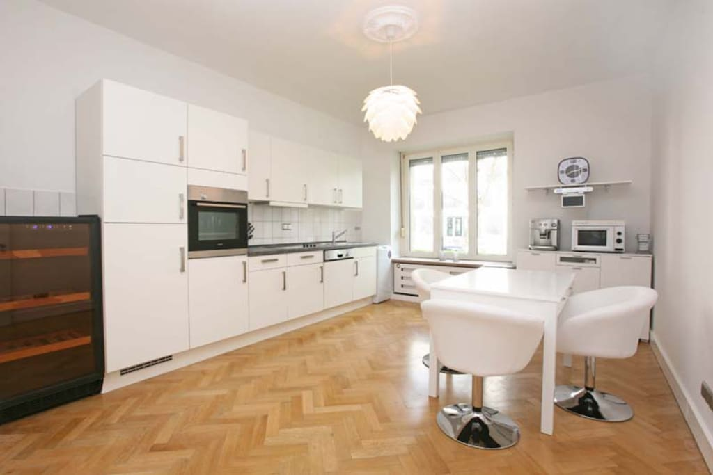 Very spacious kitchen with wine climate cabinet, dish washer, washing machine, TV-media set