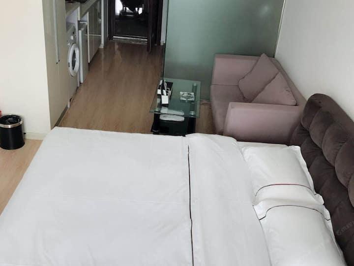 都尚华谊假日公寓(威海会展中心刘公岛店)威海市中心豪华海景大床房20