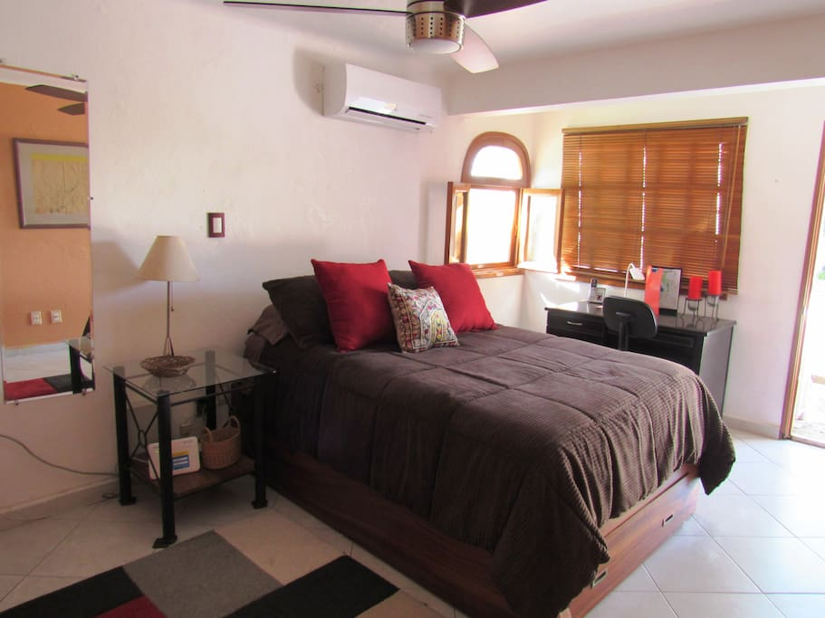 HAS A FULL SIZE BED, TRUNDLE SINGLE AND A DESK. ALSO BALCONY