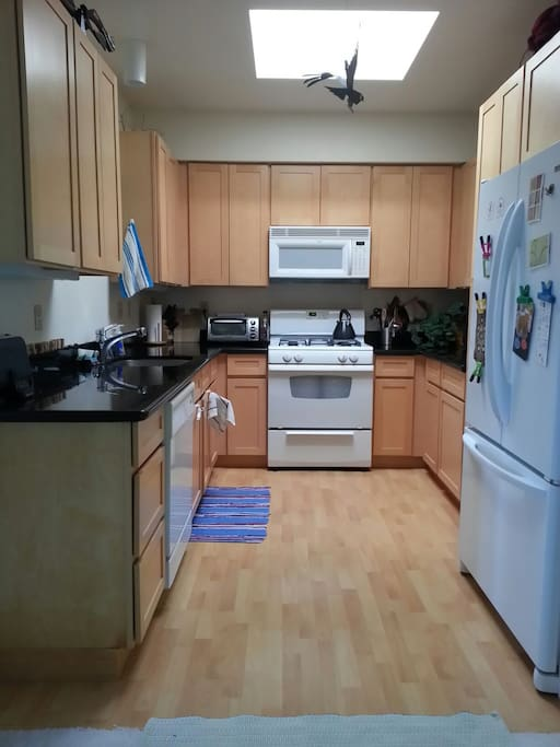 Compact but fully featured kitchen with skylight. Lots of appliances including waffle maker, blender, soda stream, crockpot, bread machine, rice cooker, juicer, coffee maker, etc.