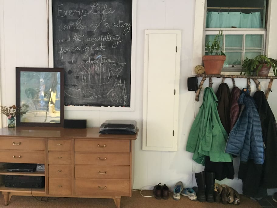 Entryway & living room.  Projector for movies & cable TV