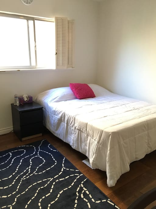 Queen size bed with nightstand.