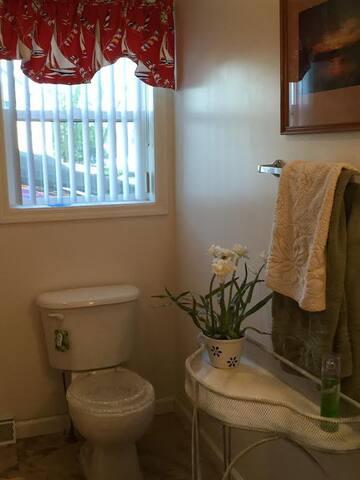 First Floor Bathroom with shower and bathtub.