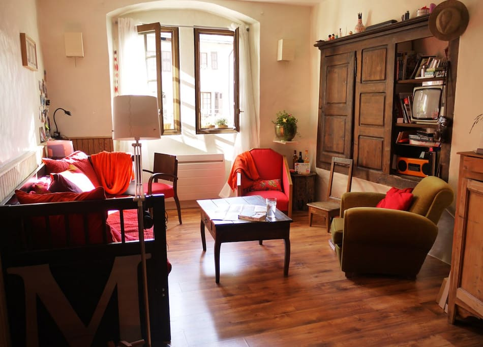 Cosy & bright living-room looks onto a lovely old square