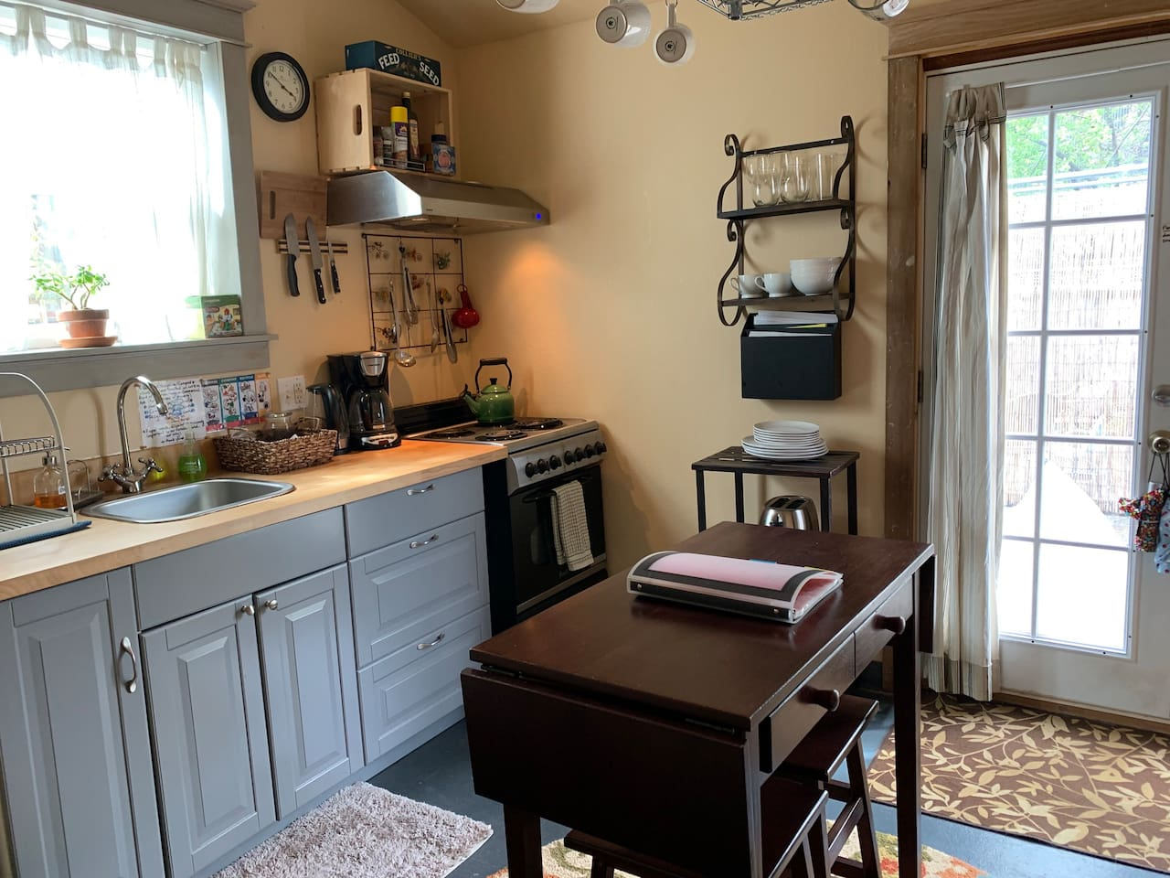 Small but functional kitchen. Most of the comforts of home. Coffee maker, full sized stove and oven, and a good sized refrigerator.