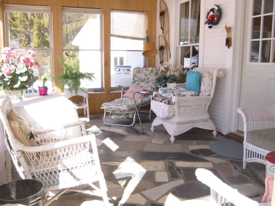 Sunny porch leads to kitchen