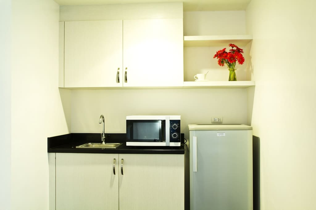 The Premiere Suite Room features a Kithchenette equipped with a 6 cubic Refrigerator, Microwave and an electric hot pot.