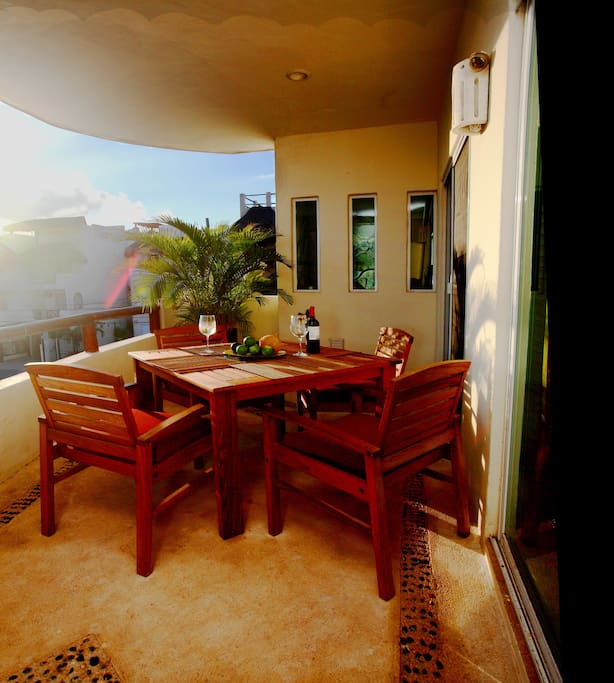 Dine outside on the terrace overlooking the road to Mamitas Beach