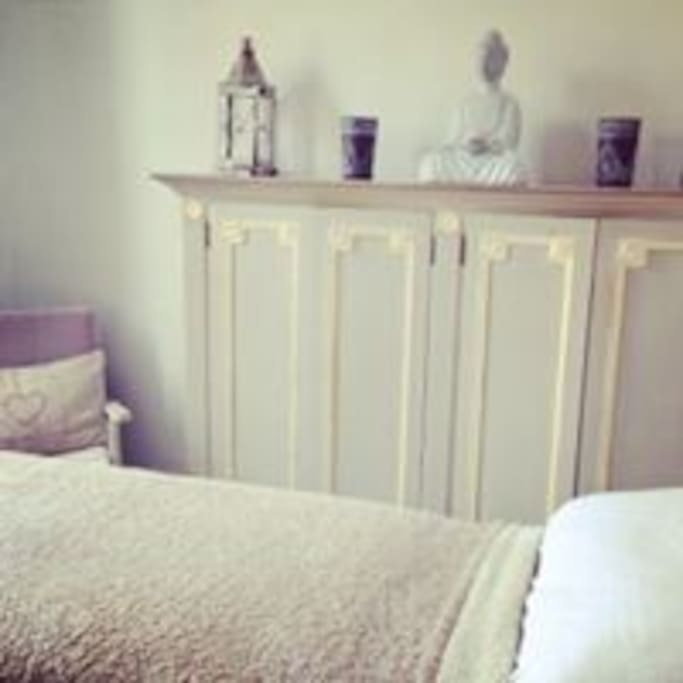 Tranquil peaceful bedroom.. with organic crisp white linen finishes.. overlooking a fairy like garden space with sweet smelling jasmine.