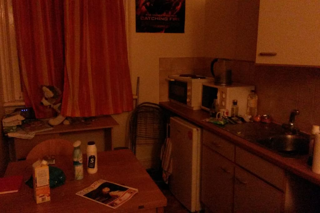 Kitchen are with microwave, table, all necessities