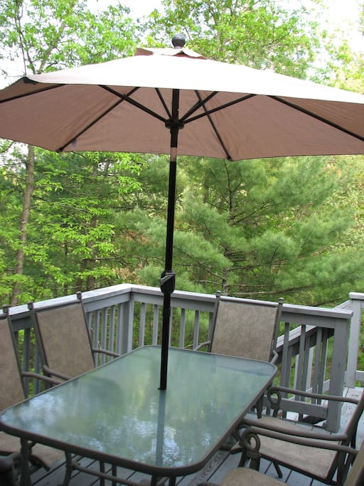 One of 2 outdoor decks.  This large deck has a table with umbrella to enjoy.