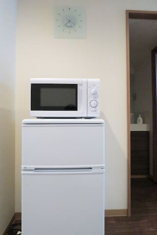 Microwave and fridge are provided