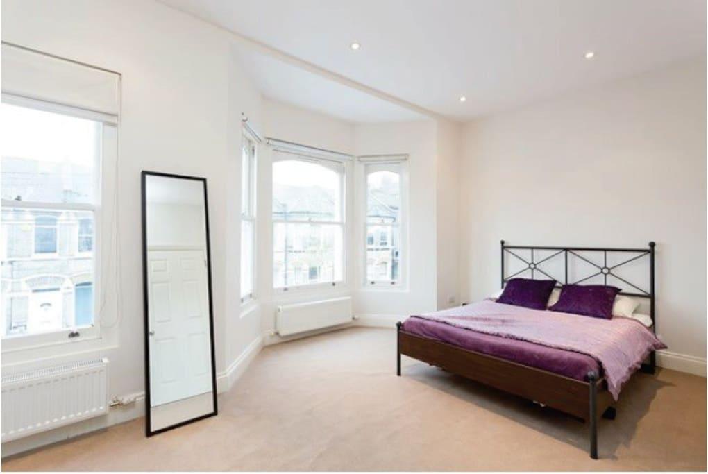 Double bed in master bedroom