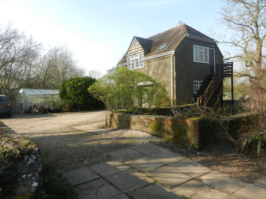 Exterior of The Old Mill B&B Annexe.  The river runs around the back and along the side of the property and under the bridge.