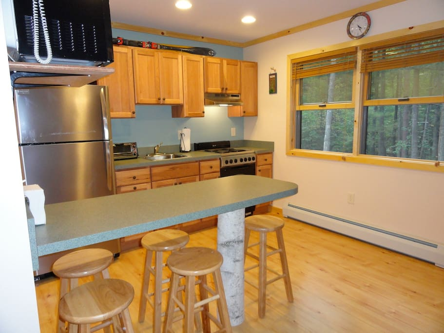 Kitchen with full refrigerator, stove, microwave, toaster oven and coffee maker.  Dishes, pots pans etc... provided