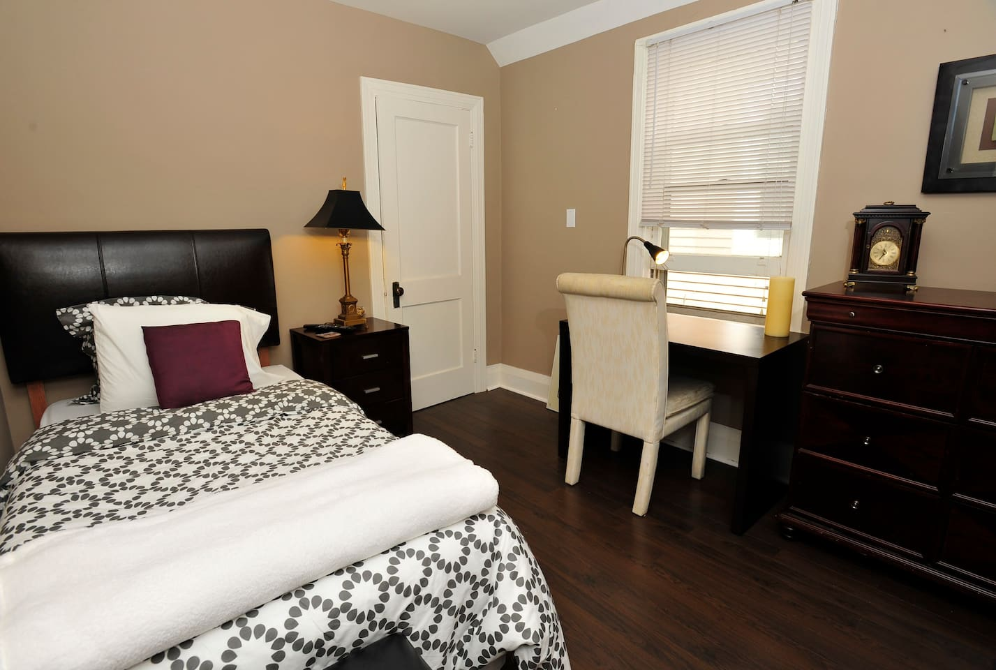 Middle bedroom - Foam mattress, study area and plenty of storage with chest of drawers and closet