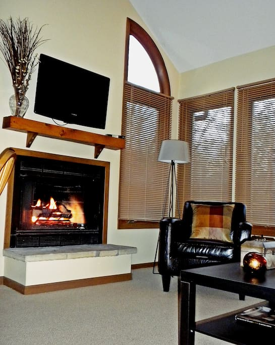 Cozy up next to the fire and enjoy the flat screen television