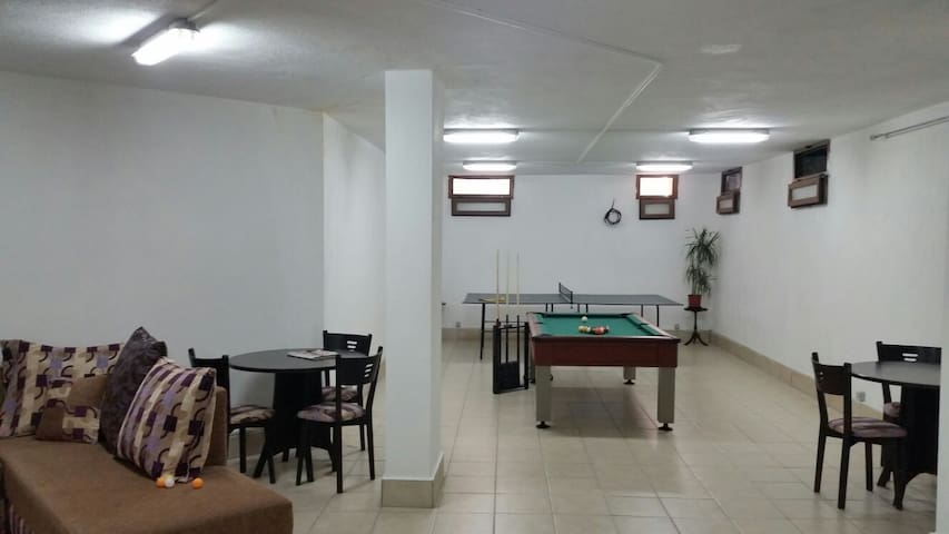 The spacious basement games area in the basement - only partly shown here also contains the last double bed for larger groups.  The basement has no windows so its a great place to escape the heat in the warm summer months