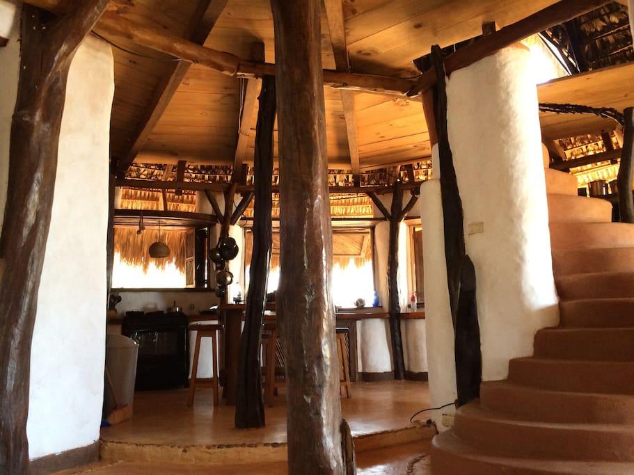 Casa de las Mariposas open plan kitchen and staircase. Cocina abierta y escalera.
