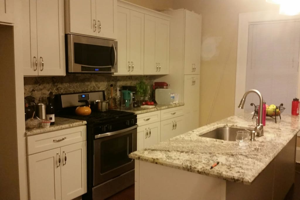 Beautiful eat-in kitchen with stainless steel appliances.