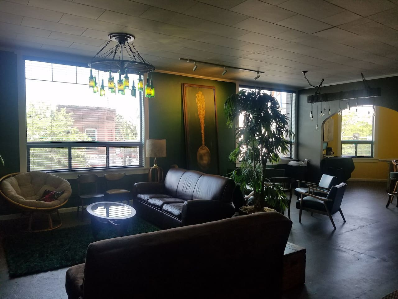 huge living room, leather couch with queen size bed