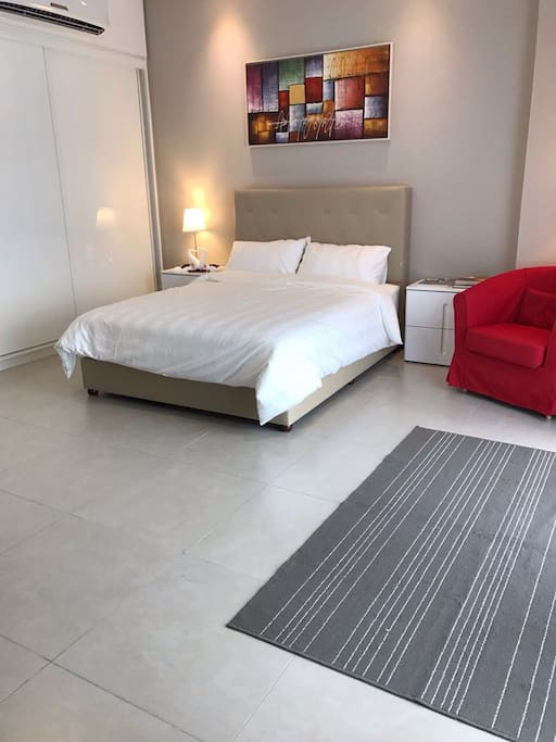 Queen Bed With Sliding Wardrobe & Sitting Area