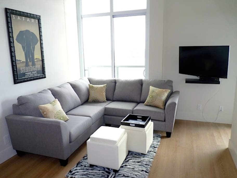 Comfy sectional couch to enjoy the views or relax watching tv.  The couch also converts into a queen bed