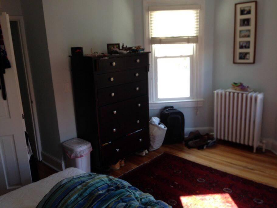 Bay windows, dresser in the bedroom