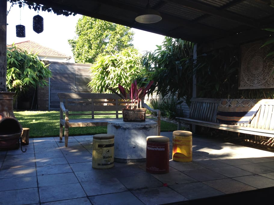 A spacious outdoor area with BBQ and outdoor shower - perfect to relax in after the beach