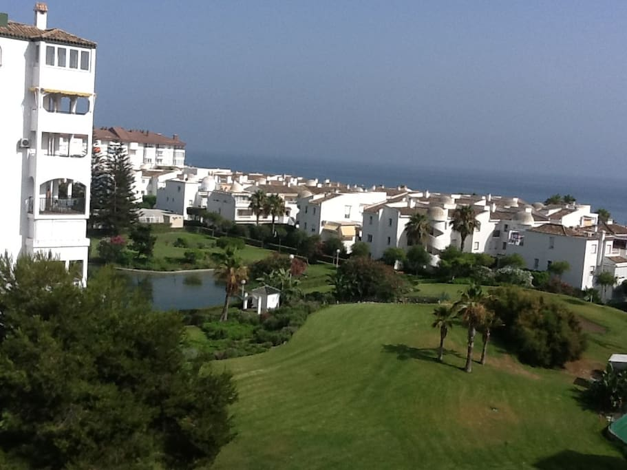 View of property, gardens and sea.
