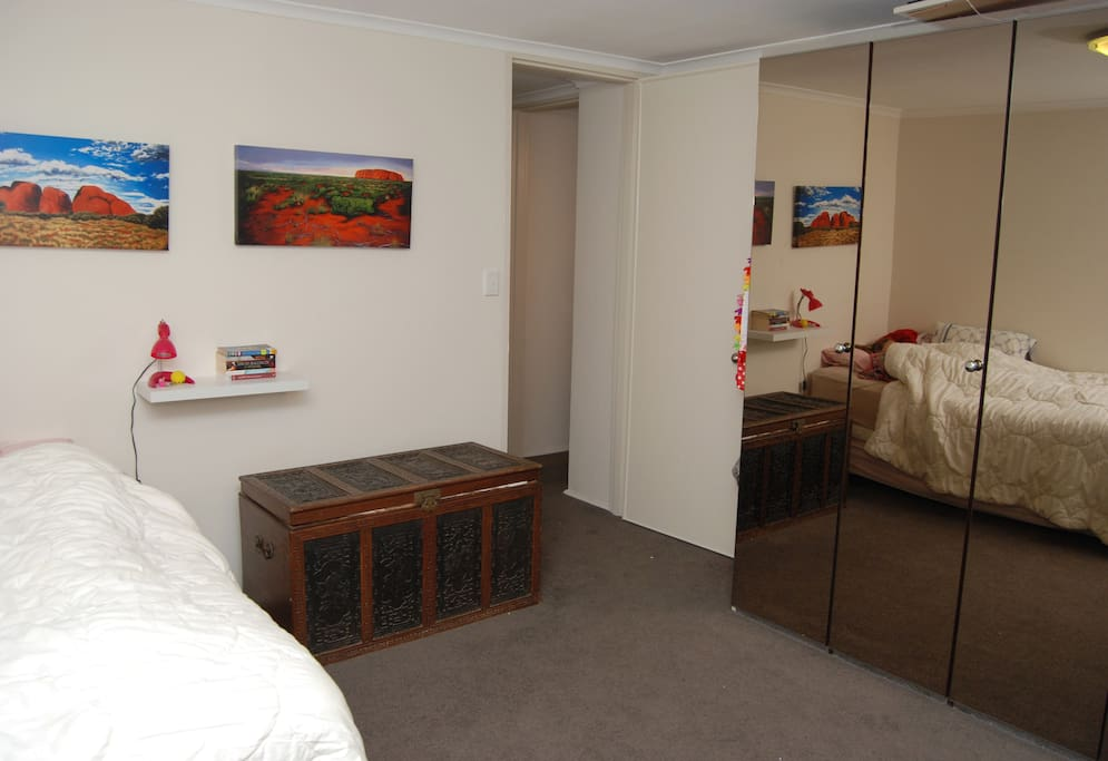 Spacious master bedroom with large window with views, mirrored wardrobe