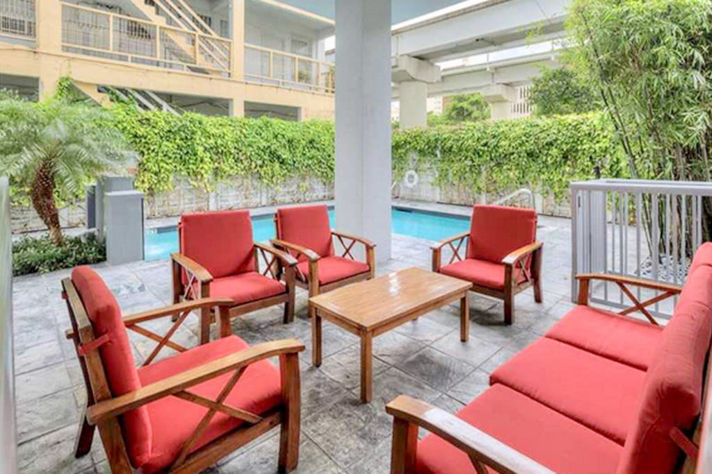 Lounge with friends or family by the heated pool surrounded by a zen garden